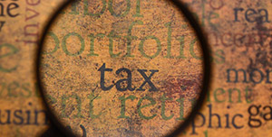 tax-text-magnified-grungy-300